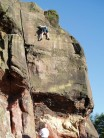 Mark Riley climbing Flake Wall E5 6a at Helsby