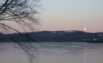 Moon rising over the Newfound Lake, NH as seen from the ice crag, after a good day of climbing.