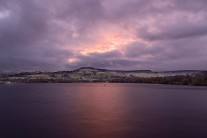 Christmas Eve dawns across the reservoir, to Castle Naze and Combs Moss.