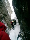 Tim Blakemore (belayed by Rich Bailey) about to tackle the crux of Gully of the Cods, Scottish VII, Vagakallen, Lofoten