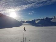 Skiing down the glacier after a winter ascent of Nørdre Bukkehøe, Jotunheimen