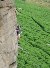 Rob Stone on Congo Corner (HVS 5b), Stanage - end of traverse