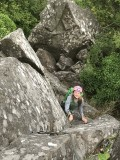 Mia smiling her way up Bramble Buttress
