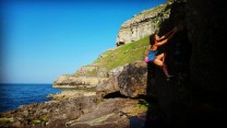 Naomi bouldering at pigeons cave on the great orme.  Llandudno