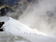 guided party emerging from the mist on the Piz Morteratsch, Bernina region