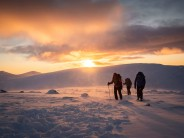 Mountaineers begin to descend at sunset above Corrie an t-Sneachda in Cairngorms National Park, Scotland.