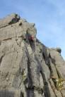 Climbing on a mountain crag in Feb