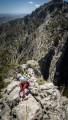 Jade moving over easy ground along the summit ridge of La Gubia Normal.<br>© JohnHartley