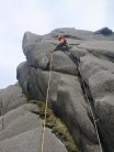 Chalking up just before the groove on Lady Rose, Bearnagh Tors.