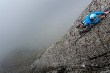 Jade making her way up Botterill's Slab in the cloud.
