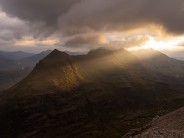 Spotlight onto a moody Liatach after a day on the Far East Wall of Coire Mhic Fhearchair