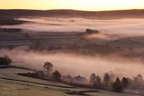 Morning mist over South Head from Cracken edge, Chinley in the Peak District