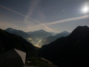 Watching the stars in the sky and the lights in the valley from the Stockhorn Biwak.  The Valais Alps, Switzerland.