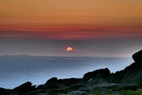 Sunset over Slieve Donard from wild camp on summit of Pen yr Ole Wen in Snowdonia