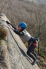 Mel reaching for the top of her first E3 - Four Pebble Slab at Froggatt Edge.