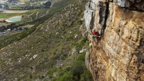 Pulling through the crux on Drop Zone at Silvermine, Cape Town