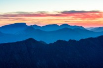 Looking over the Aonach Eagach towards the Mamores, Ben Nevis and the Aonachs | West Highlands of Scotland