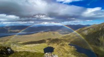 Perfect rainbow over loch beag and loch mor with a partial shot of Sgurr na lapaich (taken from An Riabhachan ascent)