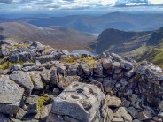 Sgurr na Lapaich trig point and shelter with views over Loch Tuill Bhearnach and Loch Mullardoch