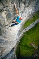 Making the final big move on An Uneasy Peace 7c+ at Malham Cove with all the exposure a person can ask for.<br>© John Thornton Photography