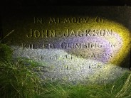 """Memorial near the belays of the central climbs at Loudoun Hill. """"In memory of John Jackson, killed climbing in the Italian"""