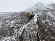 Tim tinkering about on the first full winter ascent of Metamorphosis - Central Trident Buttress, Ben Nevis.