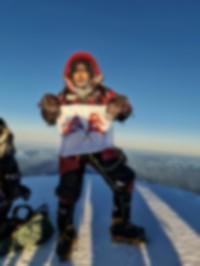 Nims Purja on the summit of K2.