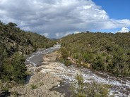 View upstream along the Murrumbidgee River with Red Rocks in the background on the right