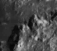 Mons Ampère (below left of centre) and Mons Huygens (above right of centre), on the moon.