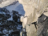Will Sim offwidth climbing on day 3 on the Petit Dru.