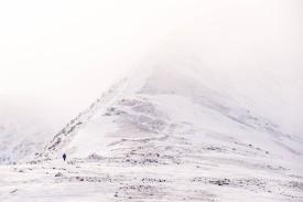 A walker disappears into the mist on Lower Man, Helvellyn., 228 kb