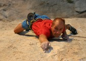 How small?! Adrian going for another tiny hold on Spartan Wall (F8b+), Kalymnos<br>© http://Climbers.net