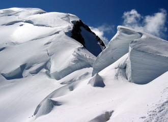 Climbers descending Bosses ridge of Mt. Blanc