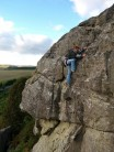 Reaching to remove gear in rather high winds  on Flies (S 4b) at Rothley Crag