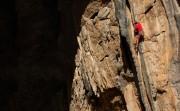 Ali on the mega cave-mouth tufa of Silvia Baraldini (6b), Canneland, Sardinia<br>© Jamie Moss