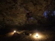 Rock atrocity by lamplight