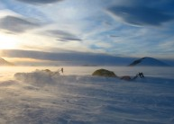 Midnight sun and spindrift, Paul Stern Land, East Greenland