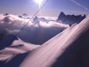 Alpinists descending the ridge